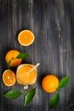 Jar mug with orange juice, above view Stock Photography
