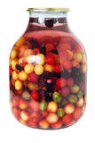 Jar of multifruit compote. Isolated on white Royalty Free Stock Image