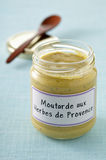 Jar of mustard with Proven?al herbs Royalty Free Stock Photo