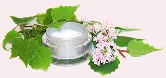 Jar natural cream sprig bloom purple white lilac cosmetic set is. Jar natural cream sprig bloom purple white lilac cosmetic set  on grey background. Feminine Stock Image