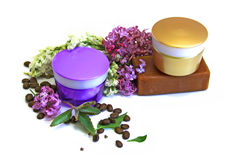Jar natural cream sprig bloom purple white lilac roasted coffee. Beans tar soap cosmetic scrub set isolated on white background. Feminine, beauty and cosmetics Royalty Free Stock Photo