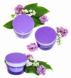 Jar natural cream sprig fresh bloom white and purple lilac persp Royalty Free Stock Photography