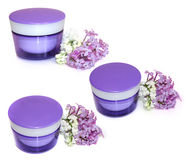 Jar natural cream sprig fresh bloom white and purple lilac persp Stock Images