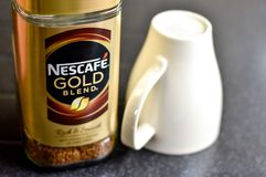 Nescafe Gold Blend instant coffee and cup Royalty Free Stock Photos