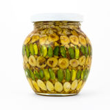 Jar with nuts and honey on white Royalty Free Stock Image