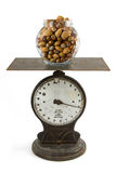 Jar of nuts on scale Royalty Free Stock Photography