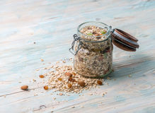 Jar of oatmeal with raisins and nuts Stock Photos