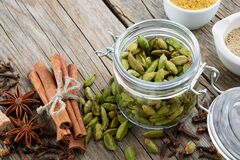 Free Jar Of Whole Green Cardamom Pods And Spices - Cinnamon Sticks, Cardamom, Allspices And Anise. Ayurveda Treatments Royalty Free Stock Photos - 169886668