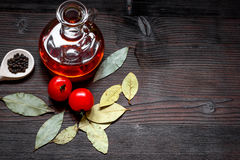 Jar with oil and tomatoes on wooden background top view Stock Photo