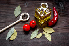 Jar with oil and tomatoes on wooden background top view Stock Photography