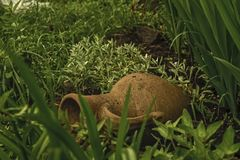 Jar. The old earthen jar lying in the garden at the cottage site Royalty Free Stock Images