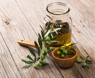 Jar with olive oil and branch of green olives Royalty Free Stock Photo