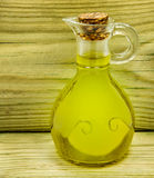 Jar of olive oil  on green wood Royalty Free Stock Images