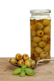 Jar of olives and spoon Royalty Free Stock Photography