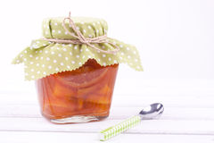 A jar of orange jam Stock Images