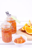 A jar of orange jam Royalty Free Stock Photography