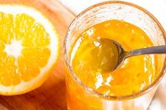 Jar with orange jam stock photo
