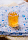 Jar with orange jam Royalty Free Stock Image