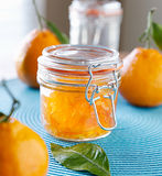 Jar of orange jam preserves. Jar of homemade orange jam with closed lid Stock Images
