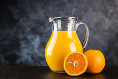 Jar of orange juice Stock Photos