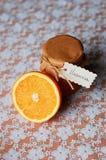Jar of orange marmalade with orange Stock Image