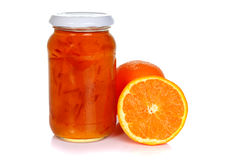 Jar of orange marmalade and oranges. On white background Stock Photography