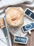 Jar of organic homemade almond butter Royalty Free Stock Image