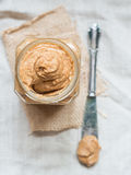 Jar of organic homemade almond butter Royalty Free Stock Images