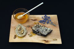 Jar with organic honey, honeycomb nut, walnut and lavender on wood Royalty Free Stock Photography