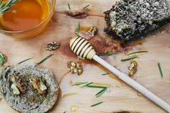 Jar with organic honey, honeycomb nut, walnut and rosemary leave Royalty Free Stock Image