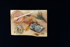 Jar with organic honey, honeycomb nut, walnut and thyme on wood Stock Photos