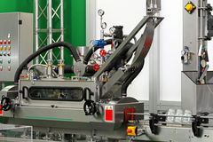 Jar packaging. Packaging machine for glass jars with lids Stock Photography