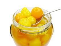 Jar of papaya in syrup Royalty Free Stock Image