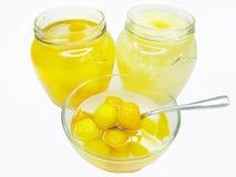 Jar of papaya in syrup and pineapple Stock Photos