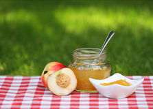 Jar of peach jam Royalty Free Stock Photography