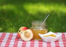 Jar of peach jam Royalty Free Stock Photography