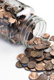 Jar of pennies tipped over Stock Images