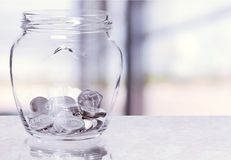 Jar. Pension currency investment coin superannuation glass stock photos