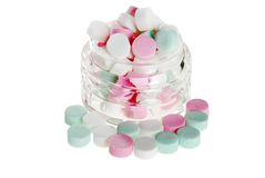 Jar of peppermints focus on bowl Royalty Free Stock Photo