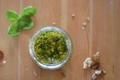 Jar of pesto sauce Royalty Free Stock Photography