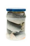 A jar of Pickled herring, isolated. On a white background Stock Photos