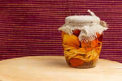 Jar of pickled variety of cheese in oil Royalty Free Stock Image