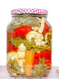 Jar with pickles containing cauliflower, cucumber, red pepper Royalty Free Stock Photography