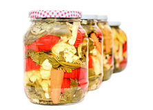 Jar with pickles containing cauliflower, cucumber, red pepper Stock Image