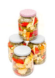 Jar with pickles containing cauliflower, cucumber, red pepper Stock Photo