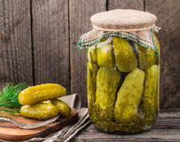 Jar of pickles. Jar of homemade pickles on a rustic wooden board Royalty Free Stock Photography