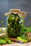 Jar of pickles on wooden table. Salted Cucumbers still-life Royalty Free Stock Image