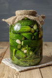 Jar of pickles on wooden table Stock Images