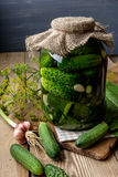 Jar of pickles on wooden table Royalty Free Stock Photos