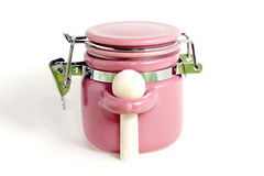 Jar pink. Pink container for spices with spoon on white background Royalty Free Stock Photo